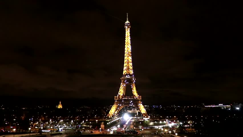 Paris, France - March 15, 2018: View of Eiffel tower illuminated at night with flashing lights, Paris, France