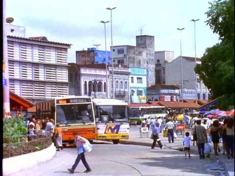 BRAZIL, 1998, Manaus, buses passing, traffic scene with people