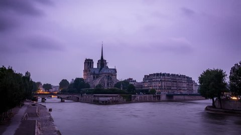 4k time lapse of night on the river Seine, Paris, France, with Notre Dame cathedral in the background