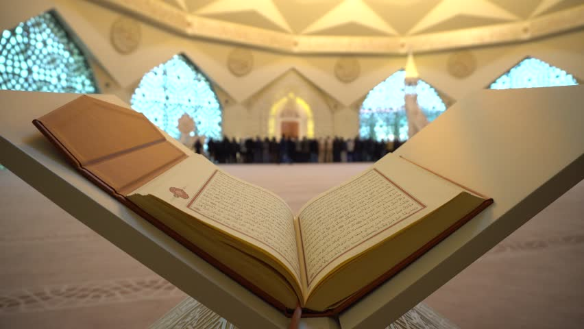 Quran or Koran - holy book and Muslim People praying in Mosque with sound  ISTANBUL, TURKEY - MARCH 2018 | Shutterstock HD Video #1010489993