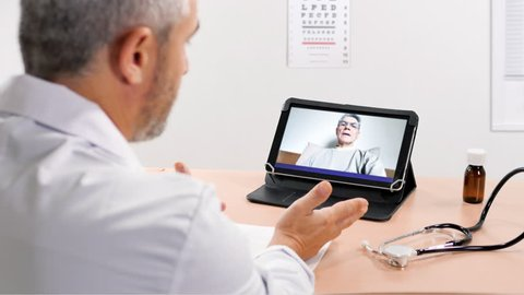 doctor having chat online with patient prescribes