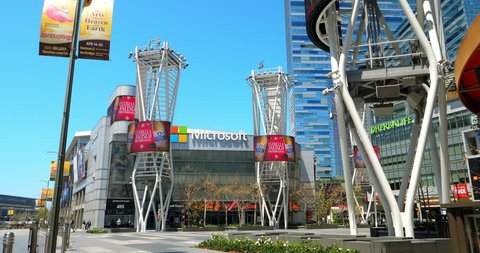 LOS ANGELES, CALIFORNIA, USA - APRIL 22, 2018: Microsoft former Nokia Square, Ritz Carlton Hotel and electronic digital billboards at L.A. LIVE in Los Angeles, California, USA, 4K