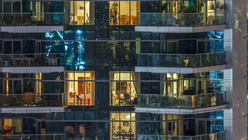 Scenic glowing windows of skyscrapers at evening timelapse. View of modern residential high-rise buildings in Dubai marina. People moving inside apartments. Aerial top view. Zoom in | Shutterstock HD Video #1010579633