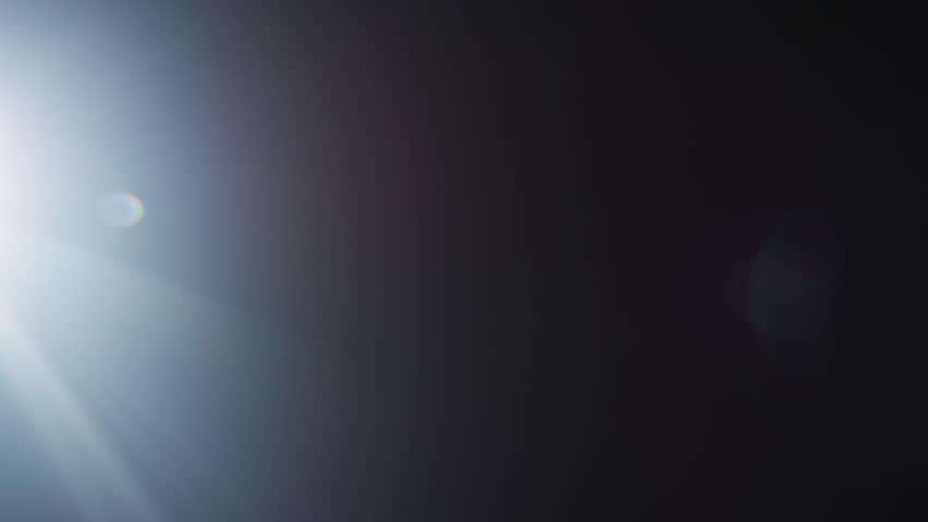 White Light Shines Making Colorful Reflection Opposite. Light Transition, Prism Effect, Light Leaks. Shot on RED EPIC-W 8K Helium Cinema Camera.