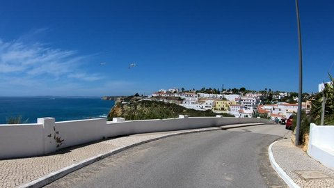 Carvoeiro, Algarve, south of Portugal - April - 2018: Driving trought Carvoeiro, located in the Algarve coast, south of Portugal.  Once a small fishing village, now become a cosmopolitan resort.