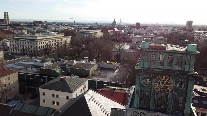Green clocktower at technical university in Munich, Bavaria, Germany