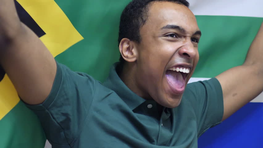 South African Fan celebrating while holding the flag of South Africa in Slow Motion
