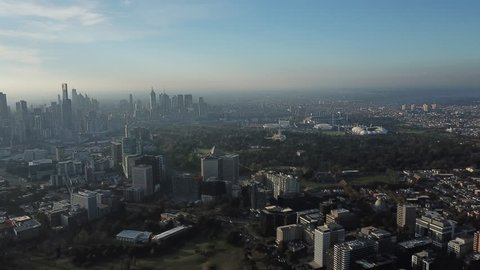slow moving pan of Melbourne CBD and the surrounding suburbs, including the MCG, AAMI park, hisense arena and rod laver arena