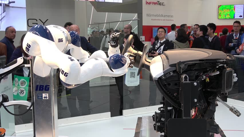 Hannover, Germany - April, 2018: IBG presenting robot and human collaboration on Messe fair in Hannover, Germany