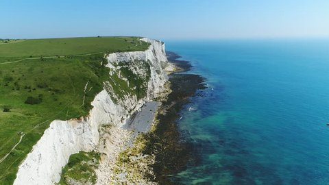 Aerial view of famous white cliffs of Dover, clear blue sky - English Channel, England, Great Britain from above, 4k UHD