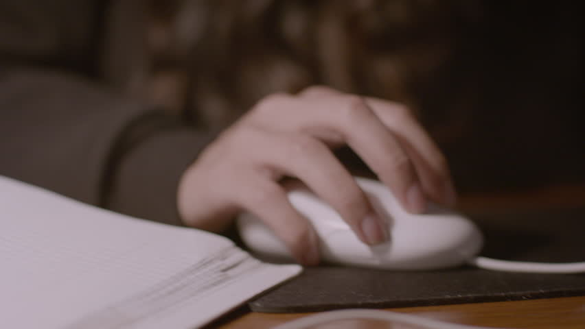 Close up of female using her computer mouse at desk HD stock video. Alexa camera