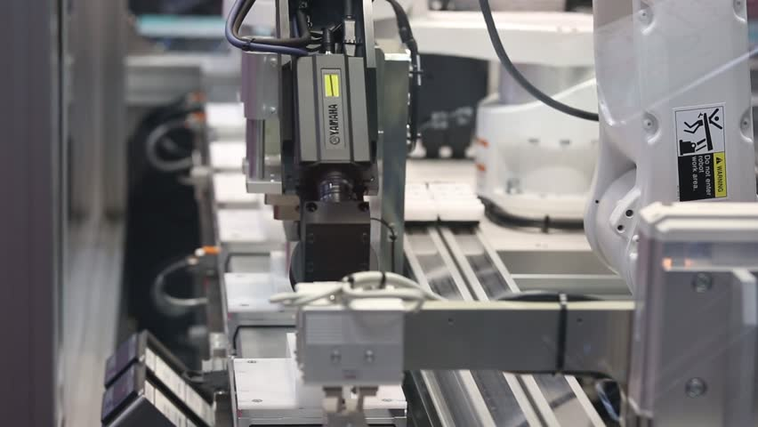 Hannover, Germany - April, 2018: Yamaha advanced robotics automation platform with automatic robot arm integrated control inspection on Messe fair in Hannover, Germany #1010741243