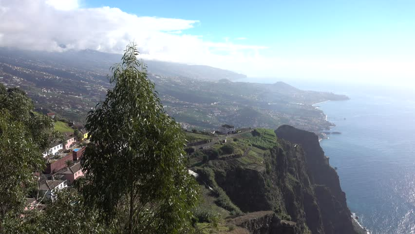 The View From The Cabo Girao Lookout Point Near Camara de Lobos The Rugged Coastline Of Madeira An Island Owned By Portugal
