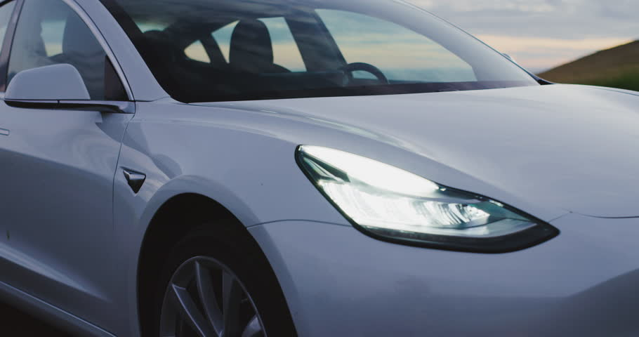 CALIFORNIA, USA - CIRCA APRIL 2018: The much anticipated Tesla Model 3 electric vehicle at sunset. | Shutterstock HD Video #1010765483