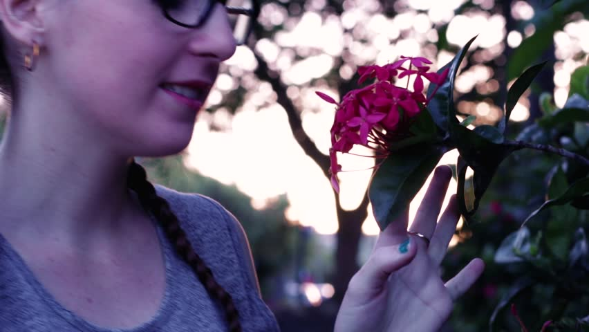 Young woman smelling a flower. Australia | Shutterstock HD Video #1010821673