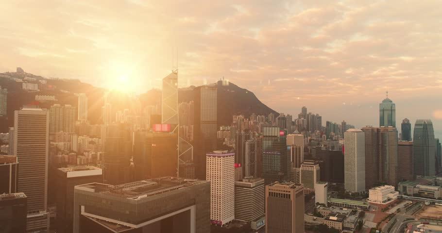 AERIAL. Hight speed flight between buildings at Hong Kong city. | Shutterstock HD Video #1010823833