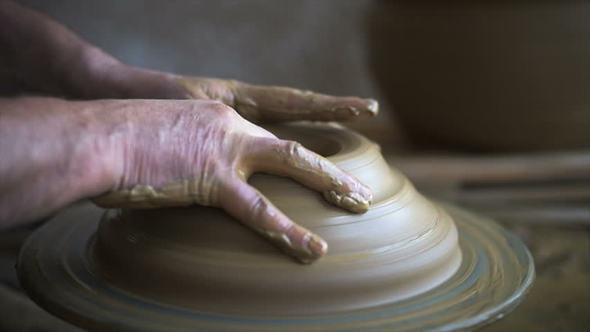Pot Maker Hand Crafting Pottery. Traditional techniques of creating pots. Potter hands working and making pottery at crafts works . Experienced potter creating a beautiful clay pot