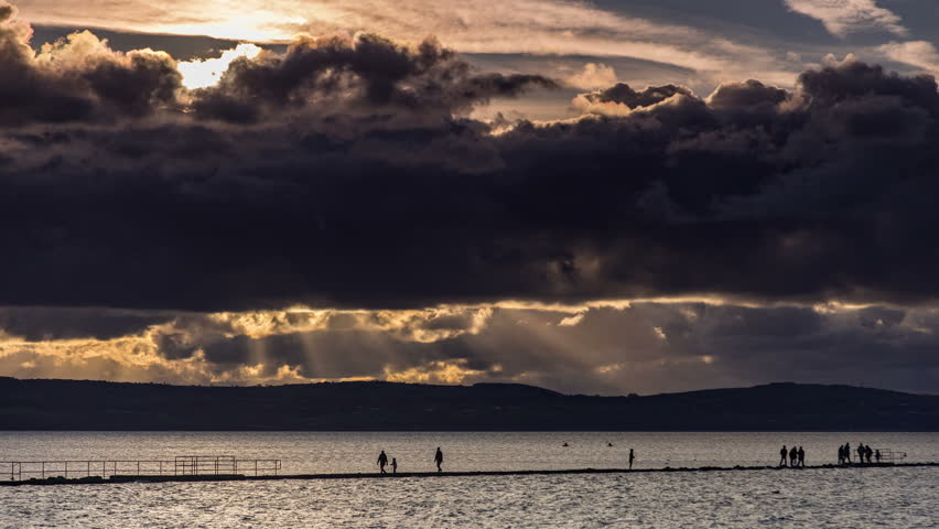 4k time lapse of clouds at sunset over the marine Lake at West Kirby, Wirral, England