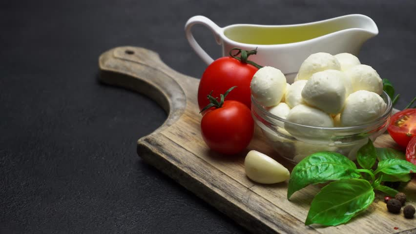 Ingredients for caprese salad - Mozzarella, tomatoes, basil leaves, olive oil