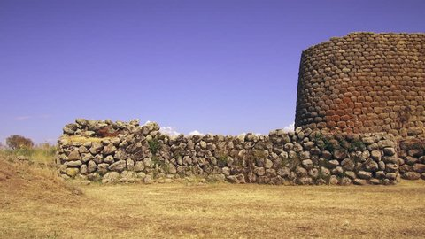 Nuraghe Losa, Abbasanta, Sardinia : pan across the prehistoric magalith stone ruins and Nuraghe tower