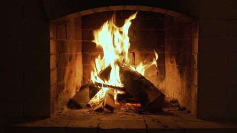 Burning Fire In The Fireplace. Wood And Embers In The Fireplace Detailed fire background. A looping clip of a fireplace with medium size flames