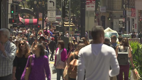Busy street scene. Crowd of people walking in a shopping street - August 2017: San Francisco, California, US