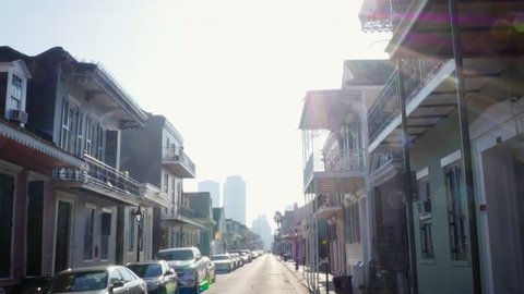 Establishing shot of a street with victorian houses in New Orleans, Louisiana. The wrought iron balconies weathered the damage from hurricane Katrina and the yearly worsening of hurricane season.