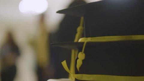 Slow motion detail shot of graduation day caps. Celebrating academic achievement