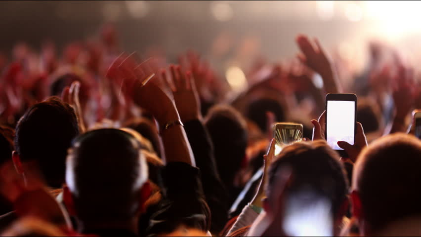 Concert crowd footage Iconic night neon rock concert cheering popular clapping hands social People lift clap hands heart led strobing Bulb stage stadium floodlights Canon EOS 5D Mark 4K Series Gallery | Shutterstock HD Video #1011038753