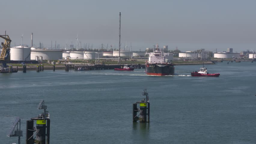 Two tugs assisting bulk carrier Arietta Lily to turn around in Calandkanaal, Europoort. ROTTERDAM SEAPORT - May 2017
