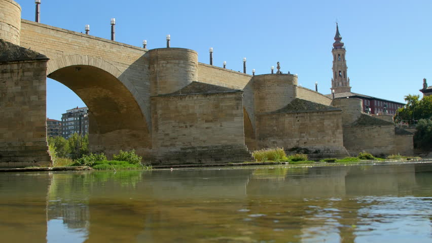 Stone Bridge and Dome of Salvador de Zaragoza Cathedral. Zaragoza, Spain.