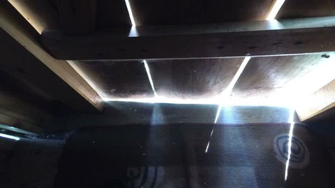 rays of light through the slits of the door.