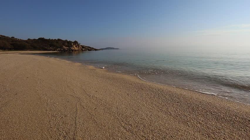 Amazing sunset view on Proti ammoudia beach near Olympiada town summer resort, Kavala region, Greece.. Incredibly romantic sunrise on the beach, Ionian Sea. View of the ocean. Tropical beach