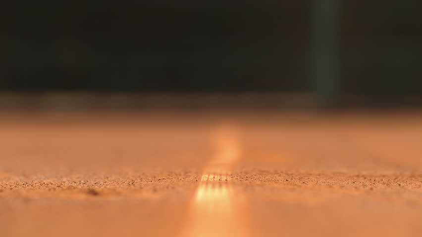 Tennis ball hitting the line on the ground | Shutterstock HD Video #1011186773
