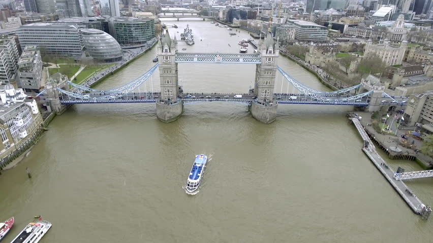 4K Aerial Birds View Tower Bridge crosses the River Thames close to the Tower of London and Modern City Hall Glass Building has become an iconic symbol of London and must see Landmark in England UK