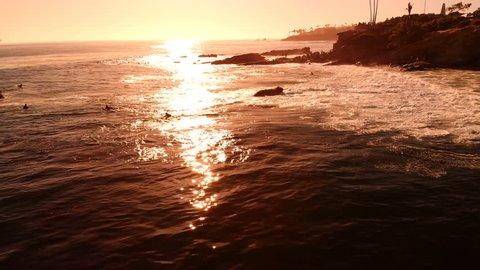 Aerial Shot of Surfers on Sunset Waves California Coastline USA