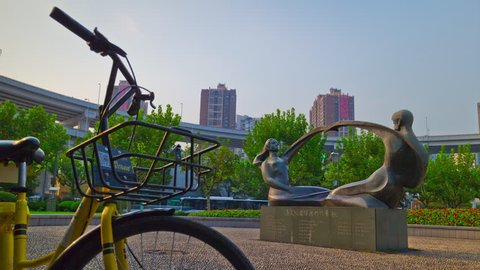 SHANGHAI, CHINA - SEPTEMBER 20 2017: day time shanghai city road junction center park bicycle and monument panorama 4k timelapse circa september 20 2017 shanghai, china.