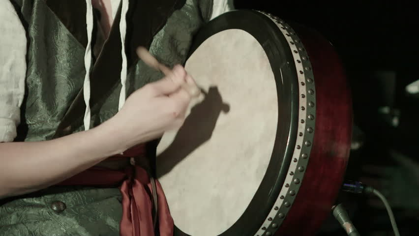 Man playing on a Bongo drum close up. Hand tapping a Bongo drum in close up. Drums hands, movement, rhythm. Ireland