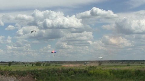 Parachute soldier or paratrooper dropping or jump from military plane