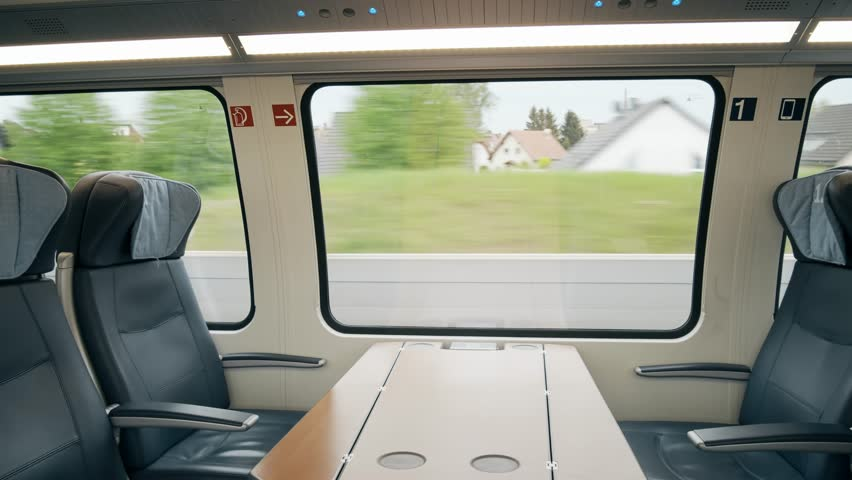 First class compartment in a moving high speed train   Shutterstock HD Video #1011240743