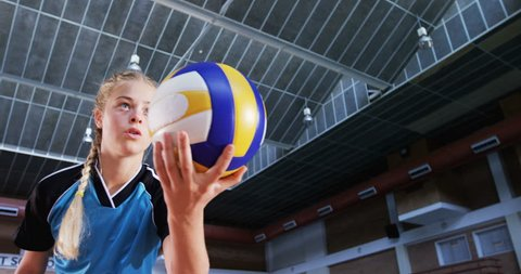 Determined player playing volleyball in the court 4k