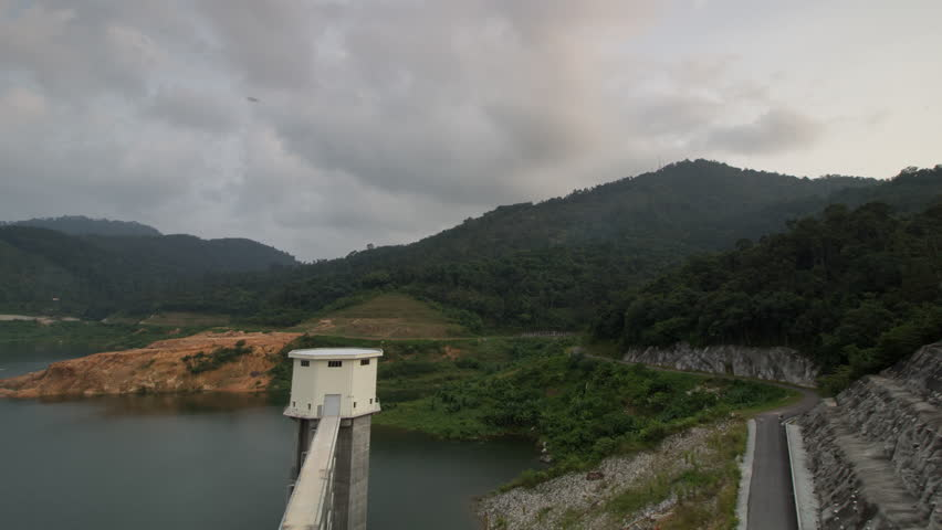 Timelapse high angle aerial view the Mengkuang Dam at Bukit Mertajam. Nature with forest nearby.