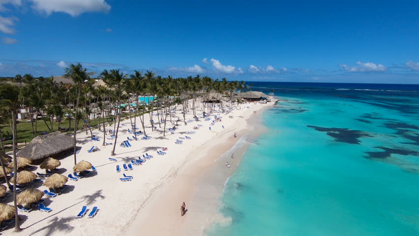 The best beaches in world. Top view of the beach of the Bahamas/Hotel on shore of blue sea. Dominican Republic, Punta Cana. White sand, beautiful beach, tall palm trees. Turquoise sea water vacation