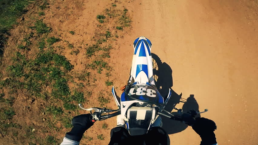 Male sportsman rides a motorcycle. First person view.   Shutterstock HD Video #1011311483