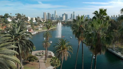 Los Angeles, California, USA - April 20, 2018 : Aerial Shot of Los Angeles Downtown Skyline Over Palm Trees and Lake in Echo Park