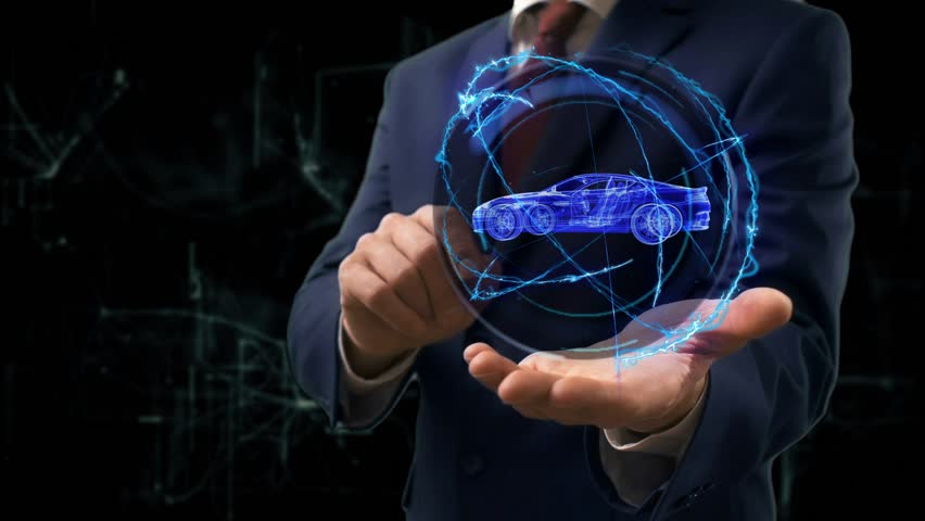 Businessman shows hologram Car on his hand. Man in business suit with future technology screen and modern background