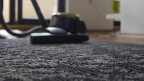 Grey Carpet Cleaning at Home with Vacuum Dust Cleaner