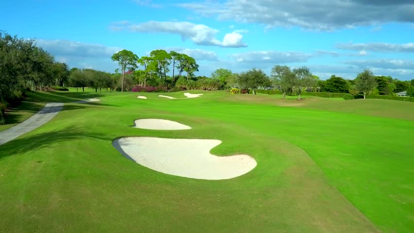 Golf Course Flyover by Aerial Drone | Shutterstock HD Video #1011428063