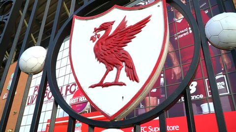 LIVERPOOL,ENGLAND - UK - DEC 7, 2017 : Red bird logo of Livepool Football club on front gate at Anfield Stadium in Mercy side, Liverpool UK. You'll never walk alone is slogan of the club.The KOP