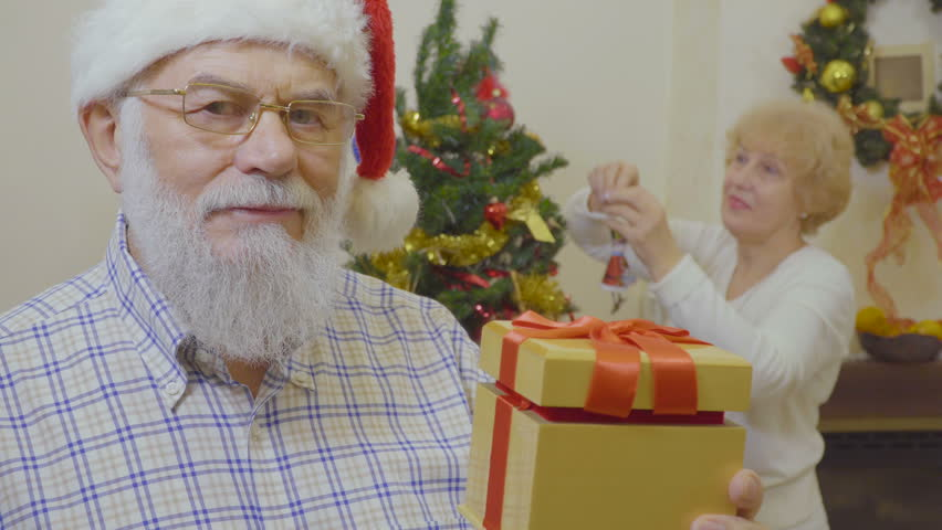 Mature man make suprise for his wife at Christmas | Shutterstock HD Video #1011438773